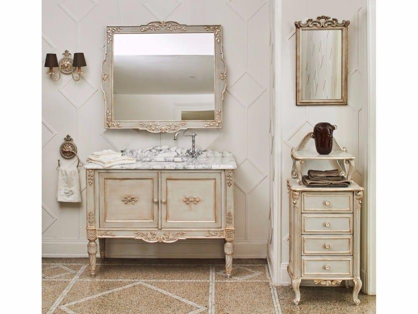 Mobile bagno completo di lavabo specchiera e portalampada