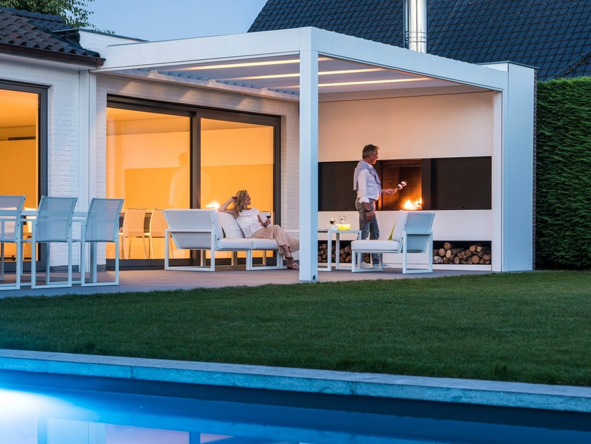 Motorized pergola with built-in lights & open fireplace CAMARGUE® by RENSON