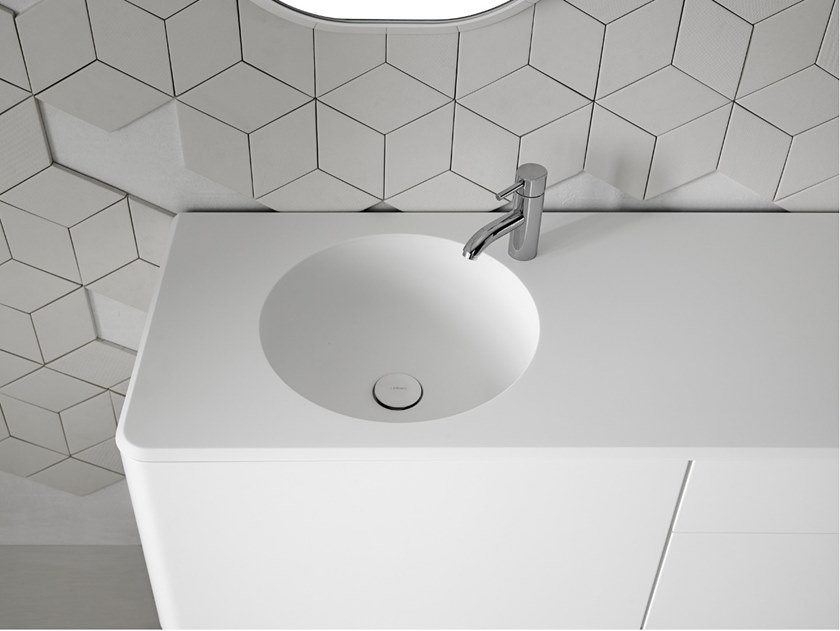 Round single Corian® washbasin with integrated countertop CERCLO by INBANI