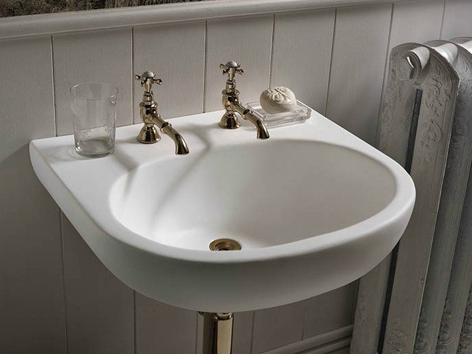 Single wall-mounted Corian® washbasin Corian® CALM by DuPont Protection Solutions