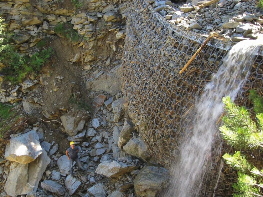 Protective mesh against debris flows Debris flow barrier UX by GEOBRUGG