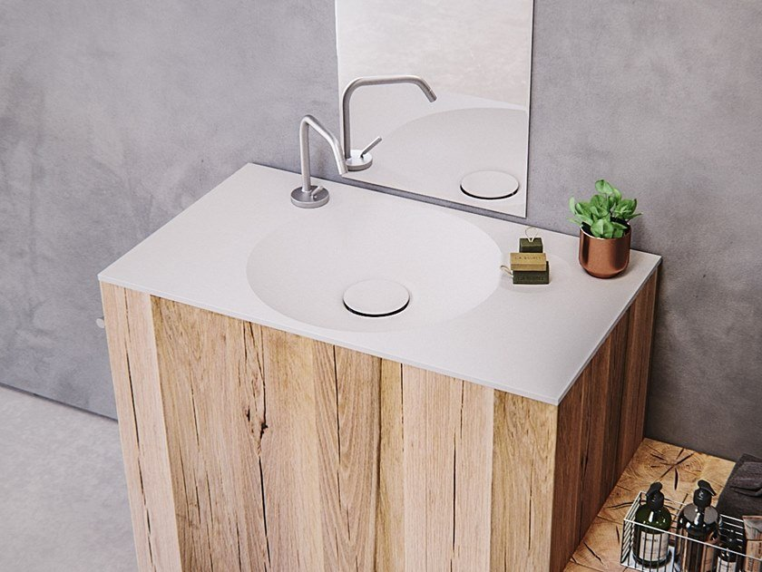 Round Meridian Solid Surface® washbasin with integrated countertop EROSION-02 by Le Projet
