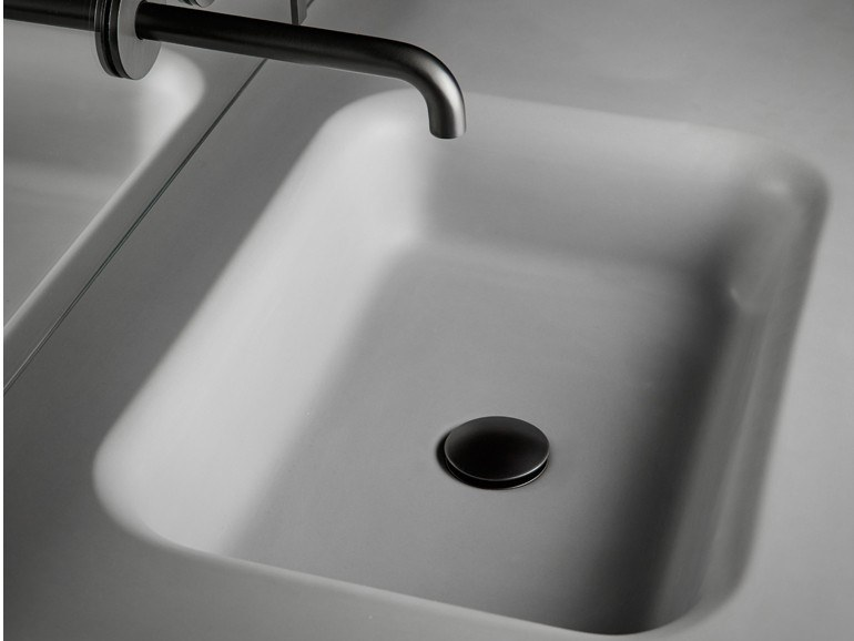 Single Cementsolid washbasin with integrated countertop FLOAT | Cementsolid washbasin by INBANI