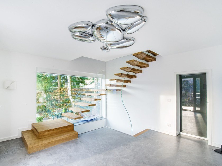 L-shaped glass cantilevered staircase FLOATING WAVES | Cantilevered staircase by Siller Treppen