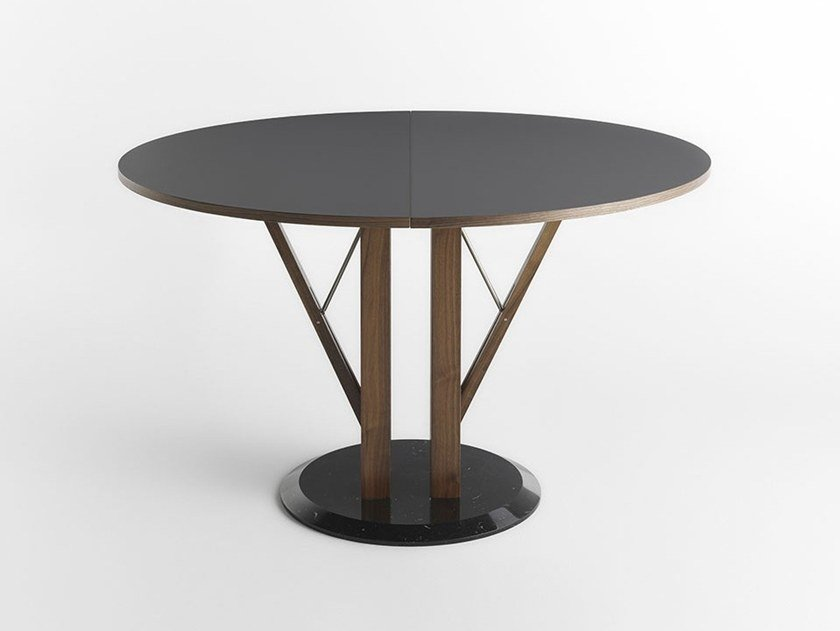 Extending round Fenix-NTM® table FLOWER by Casamania & Horm
