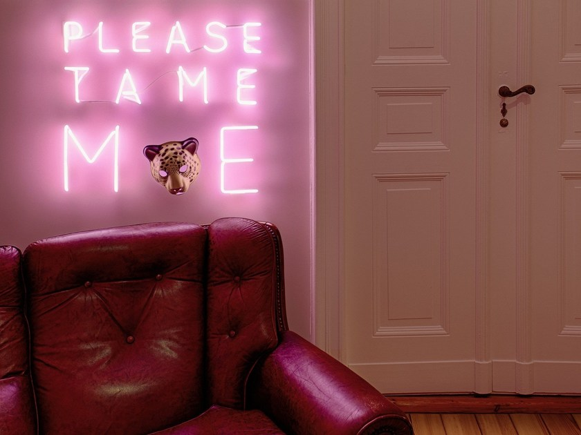 Wall-mounted neon light installation FRIENDSHIP by sygns