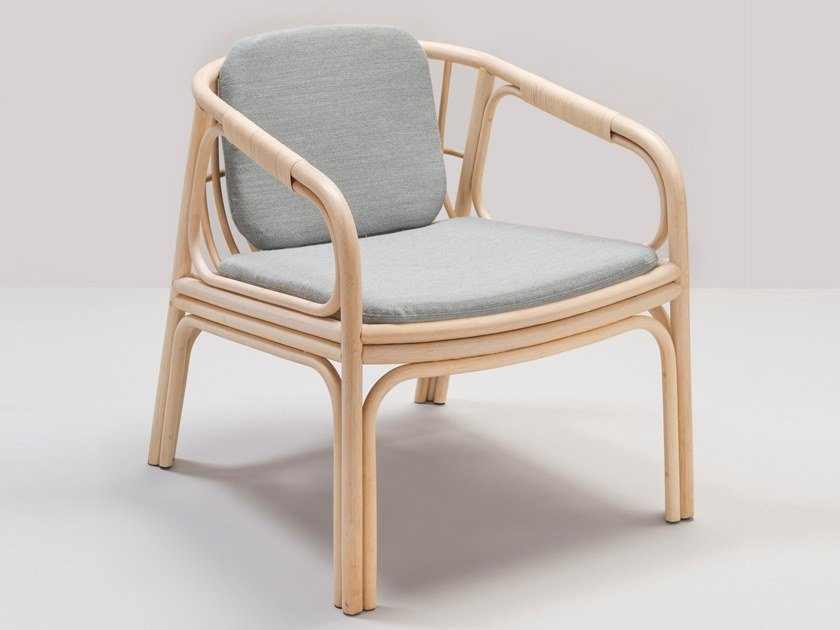 Upholstered rattan easy chair with removable cover with armrests HUBLOT by Orchid Edition