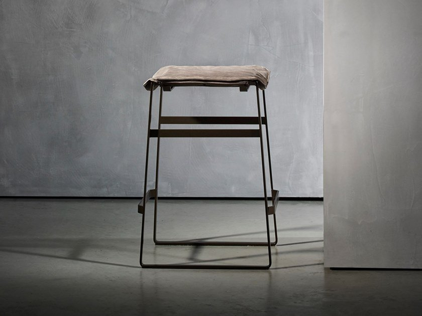 Upholstered sled base stool with footrest KEKKE LIVING | Stool by Piet Boon