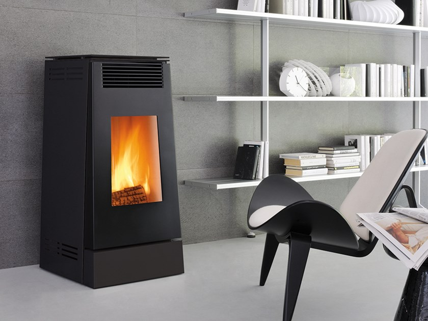 Wood-burning Class A wall-mounted steel stove LINEA XW | Wood-burning stove by CAMINETTI MONTEGRAPPA