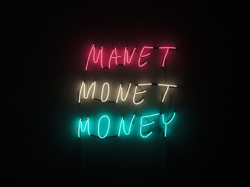Wall-mounted neon light letters MANET MONET MONEY by sygns