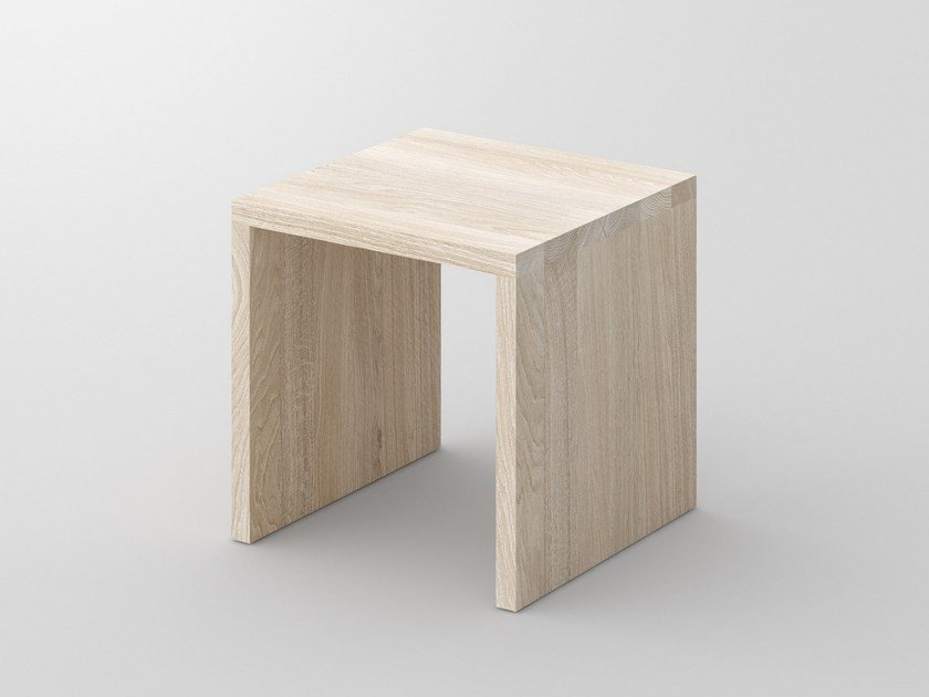 Low solid wood stool MENA | Stool by Vitamin Design
