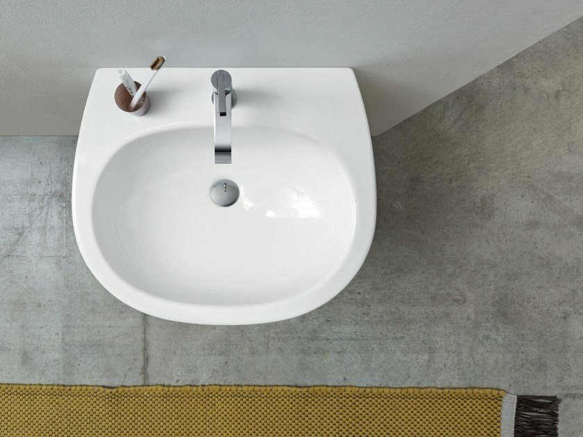 Wall-mounted ceramic washbasin MILK | Wall-mounted washbasin by Nic Design