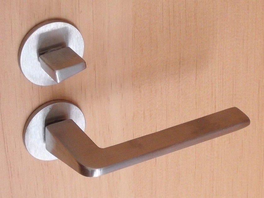 Door handle on rose Door handle by Capoferri Serramenti