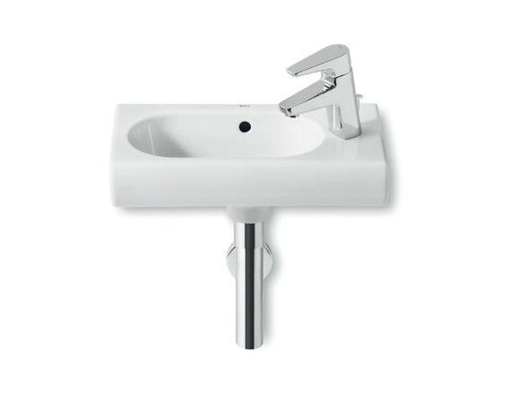 Wall-mounted ceramic handrinse basin NEW MERIDIAN | Wall-mounted handrinse basin by ROCA SANITARIO