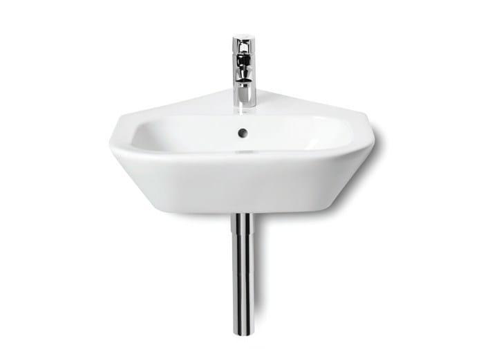 Corner wall-mounted handrinse basin with overflow NEXO | Corner handrinse basin by ROCA SANITARIO