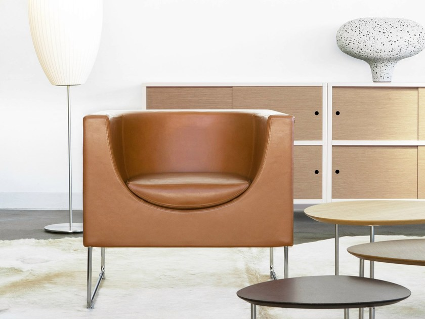 Sled base leather easy chair with armrests NUBE | Leather easy chair by STUA