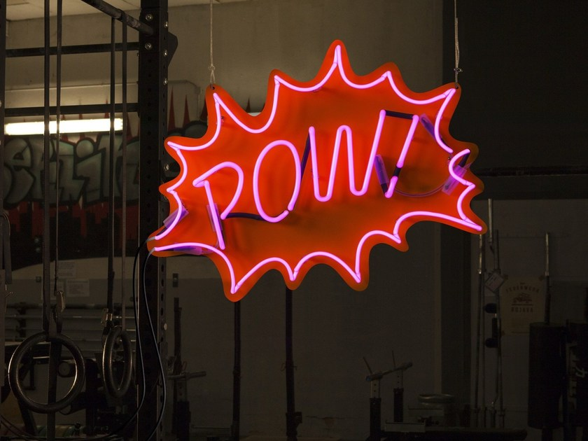 Wall-mounted neon light installation POW by sygns