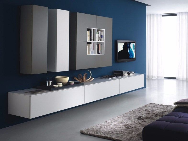 Sectional wall-mounted storage wall QUADRA | Storage wall by Composit