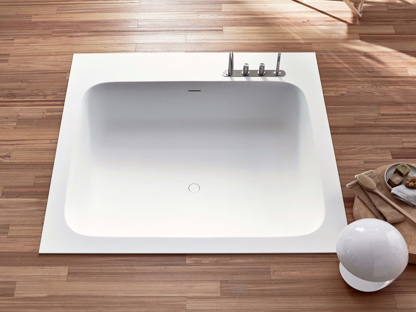 Square built-in Corian® bathtub R1 | Built-in bathtub by Rexa Design