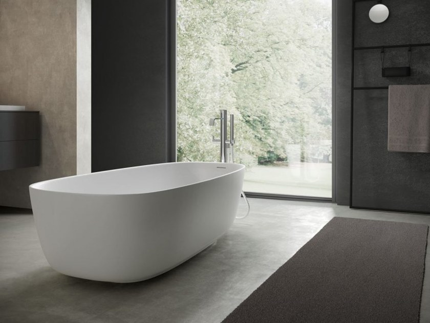 Freestanding oval Aquatek bathtub RIVER | Bathtub by DISENIA
