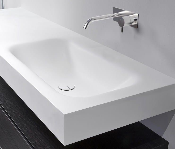 waschbecken aus corian mit waschtisch segno by antonio lupi design design nevio tellatin. Black Bedroom Furniture Sets. Home Design Ideas