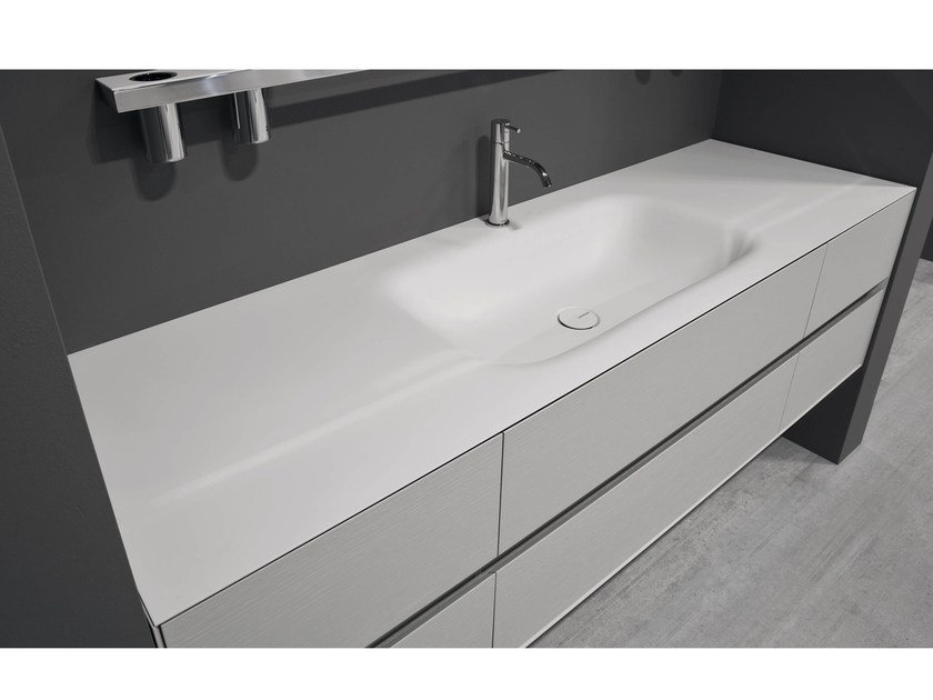 Corian® washbasin with integrated countertop SEGNO by Antonio Lupi Design