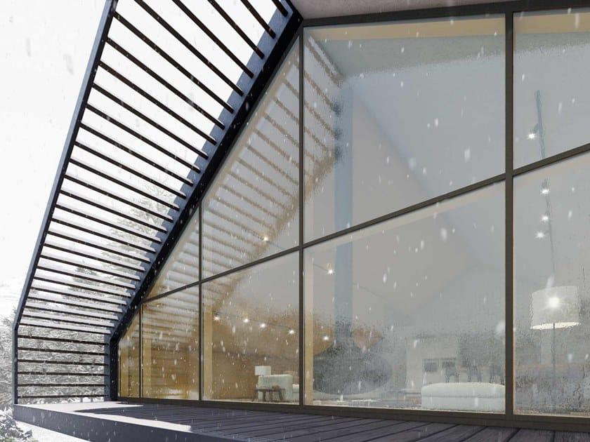 Sistema di facciata continua in legno SKYLINE FACADE by CARMINATI SERRAMENTI