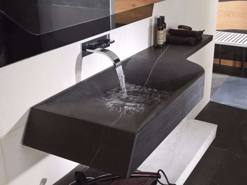 Wall-mounted natural stone washbasin with integrated countertop SPIRIT | Washbasin with integrated countertop by L'antic Colonial