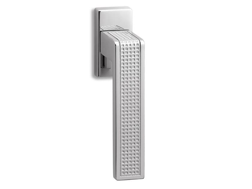Brass window handle on rose TECA QUADRO   Window handle by Ento