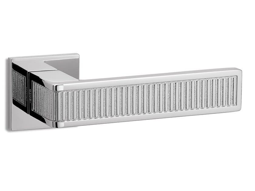 Brass door handle on rose TECA RIGA | Door handle by Ento