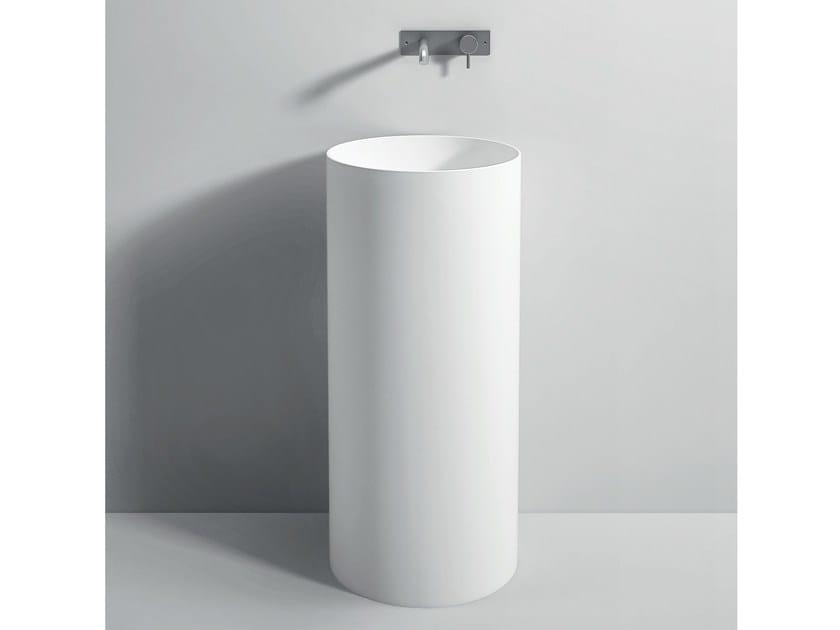 Lavabo freestanding rotondo in Corian® UNICO   Lavabo freestanding by Rexa Design