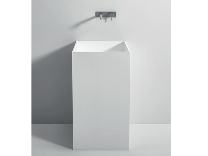 Freestanding single Corian® washbasin UNICO | Freestanding washbasin by Rexa Design