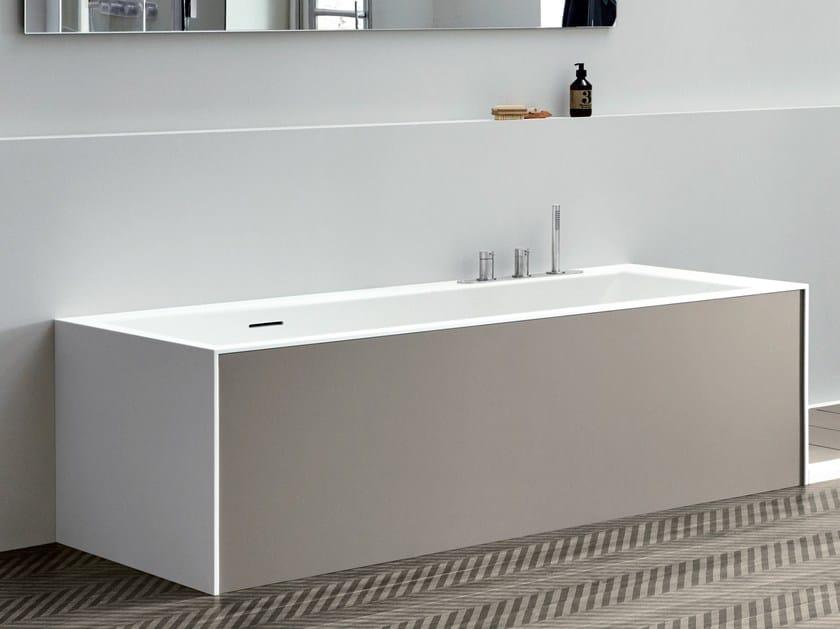Rectangular Corian® bathtub UNICO WITH PANELS by Rexa Design
