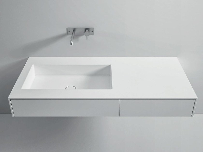 Wall-mounted Corian® washbasin with integrated countertop UNICO | Washbasin with drawers by Rexa Design
