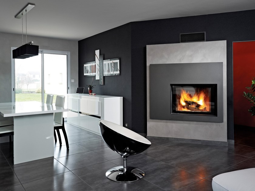 Wood-burning steel fireplace with panoramic glass URANUS by RÜEGG