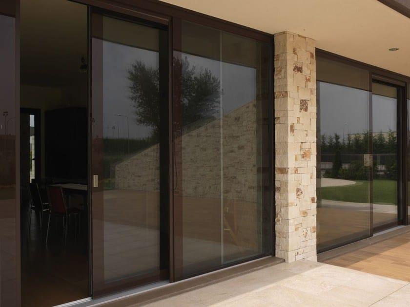 Wood and glass patio door VITRUM 90 by CARMINATI SERRAMENTI