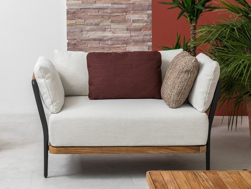 Upholstered fabric garden armchair with armrests FLEX | Armchair by MANUTTI