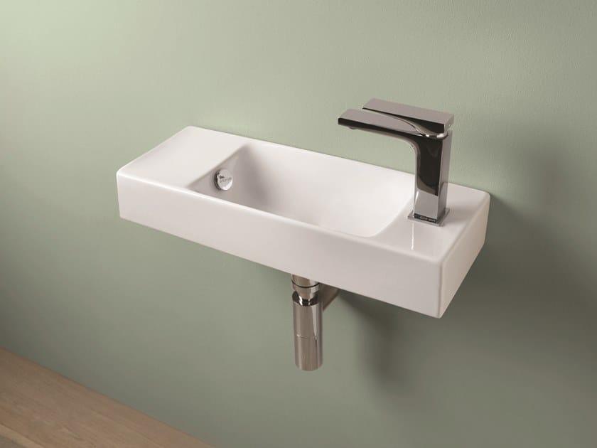 Rectangular wall-mounted ceramic handrinse basin BRICK by Artceram
