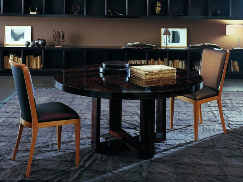 Round ebony table C 1321 | Table by Annibale Colombo