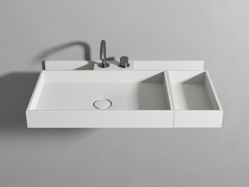 Corian® washbasin with organizer and trays Washbasin with organizer and trays by Rexa Design