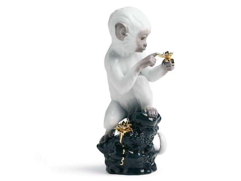 Porcelain decorative object CURIOSITY MONKEY ON BLACK ROCK by Lladró