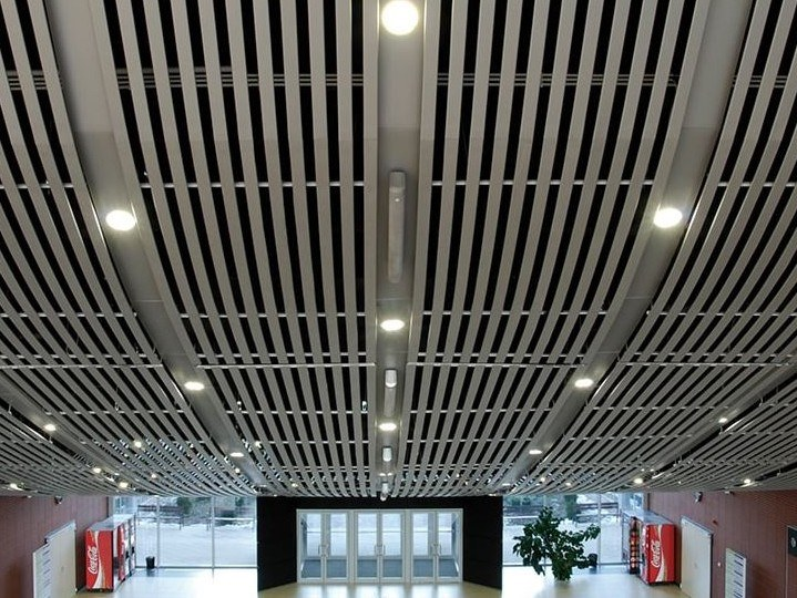 Acoustic metal ceiling tiles CURVED CARRIER by HunterDouglas Architectural