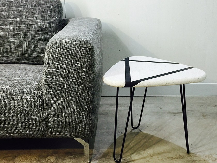 Triangular stone coffee table ETC | Triangular coffee table by Atelier Bussière