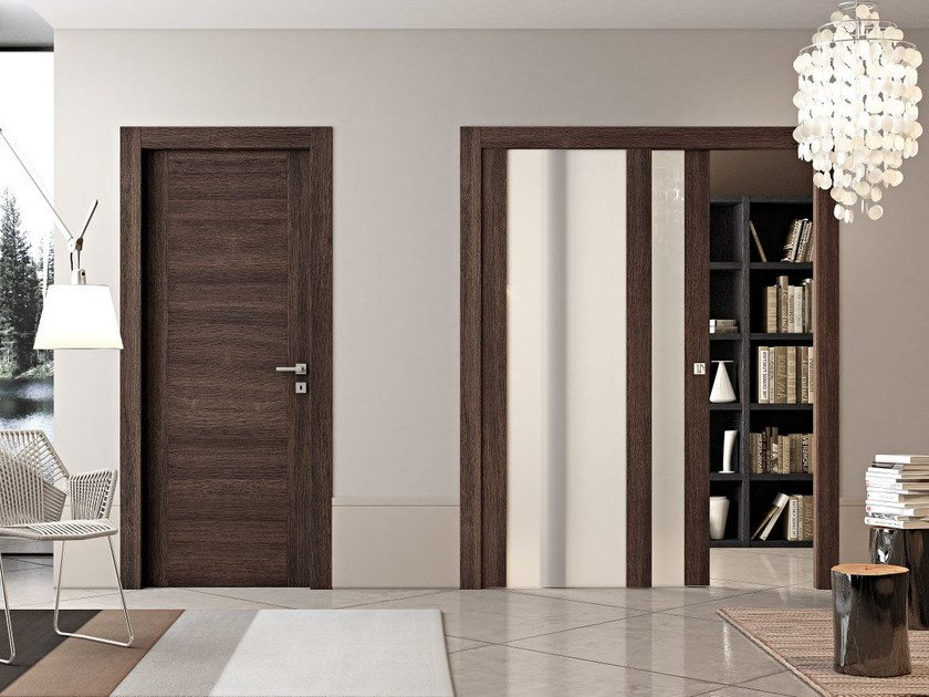 Wood and glass pocket sliding door GEO | Pocket sliding door by Pail Serramenti