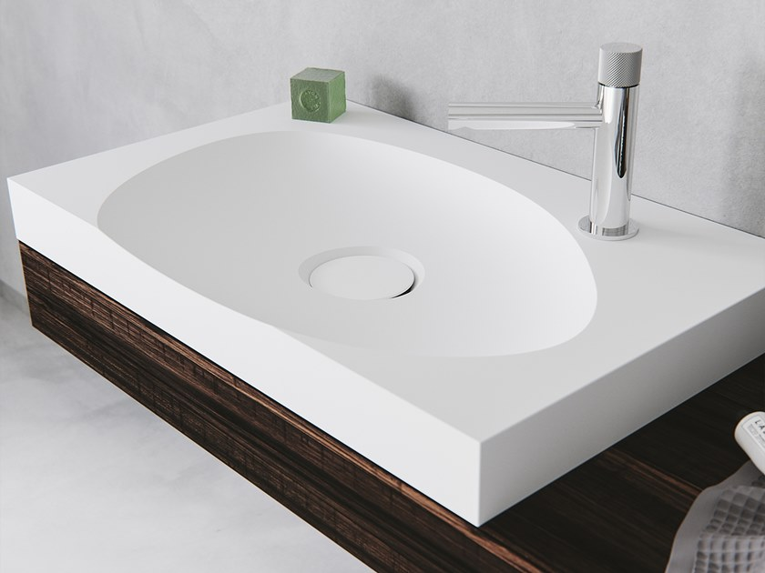 Oval single washbasin with integrated countertop LAGOON-02 by Le Projet