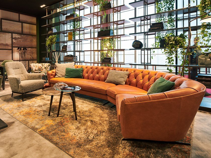 Tufted sectional curved leather sofa