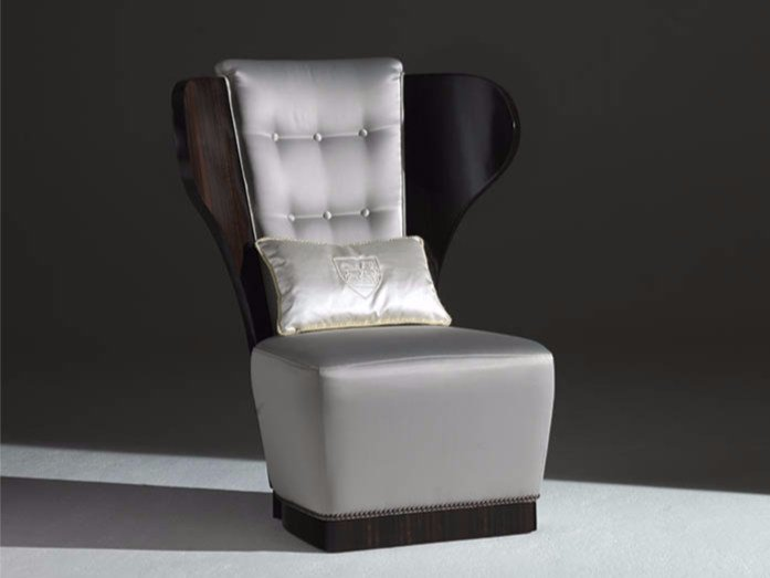 Tufted upholstered fabric wingchair TEO by Rozzoni