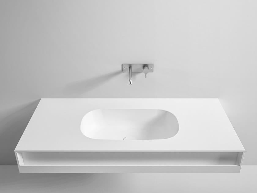 Wall-mounted Corian® washbasin with towel rail MOODE | Washbasin with towel rail by Rexa Design