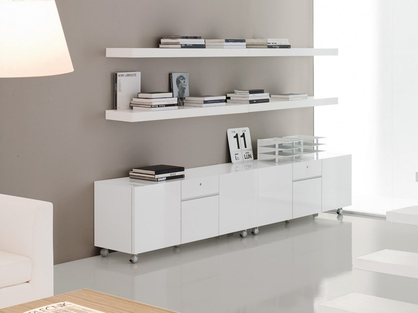 Lacquered office storage unit with casters Office storage unit with casters by Martex