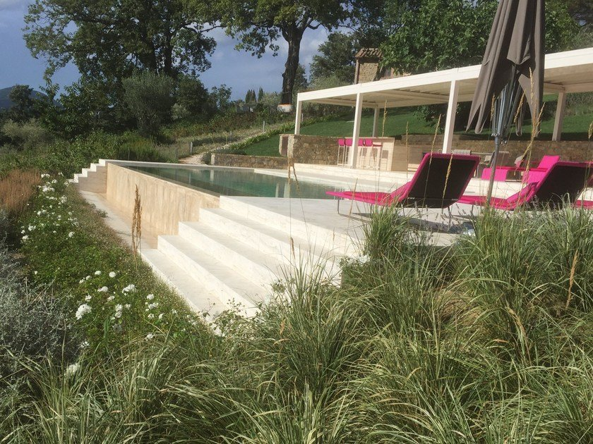 Infinity In-Ground stone swimming pool Infinity swimming pool by INDALO PISCINE